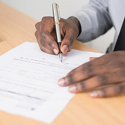writing-signing-document-paper-form